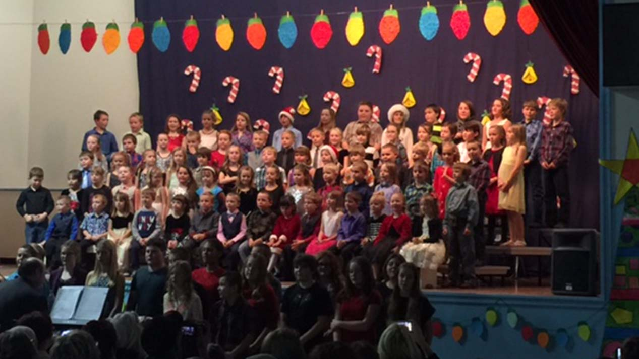 Children's school choir standing on risers